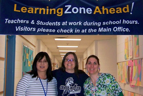 Banner that reads: Learning Zone Ahead, Picture of D.Natour, D. Hensley, and H. Smith