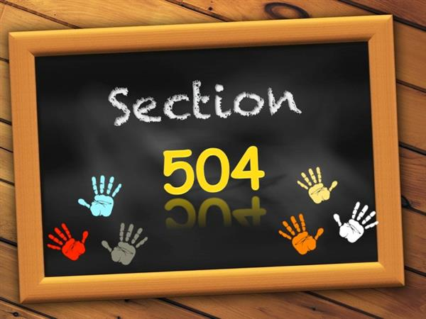 Chalkboard with Section 504 and childrens' handprints.