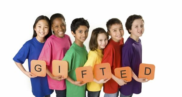 "Picture of students holding the word ""gifted"""