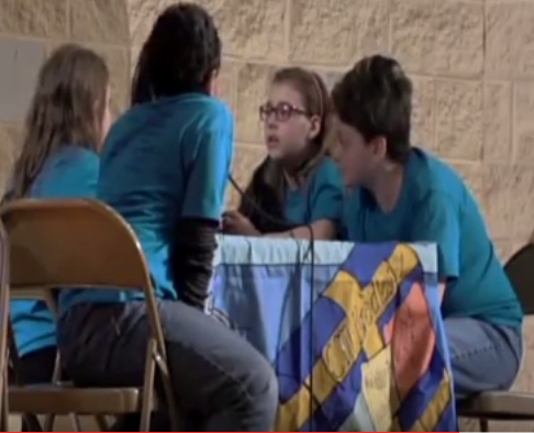 Image of students participating in Battle of the Books tournament.