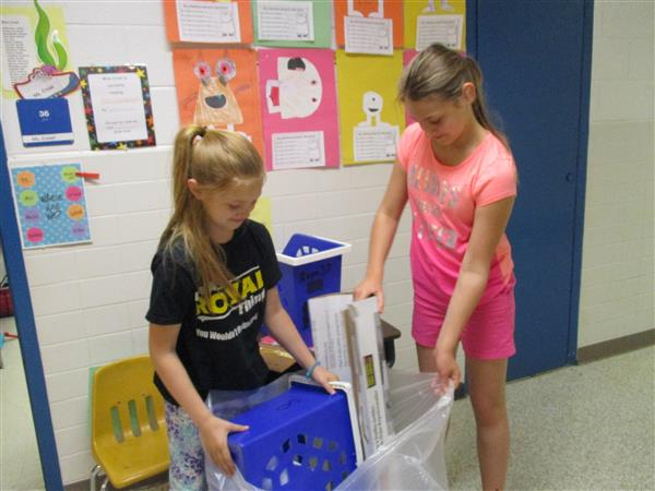 Image of students recycling